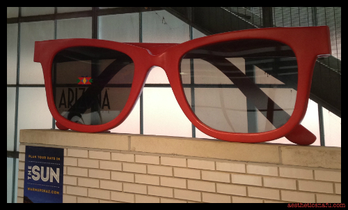 giant sunglasses advertising Arizona at CTA Station