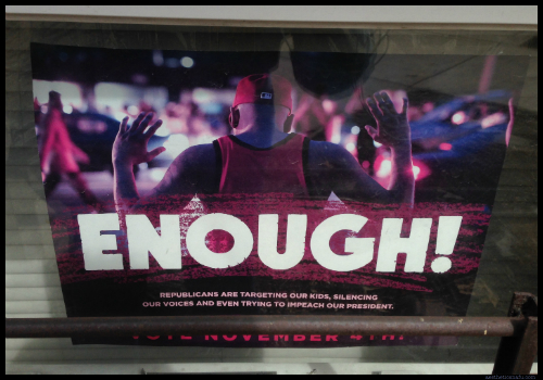 Enough poster in Chicago window saying Republicans are racist